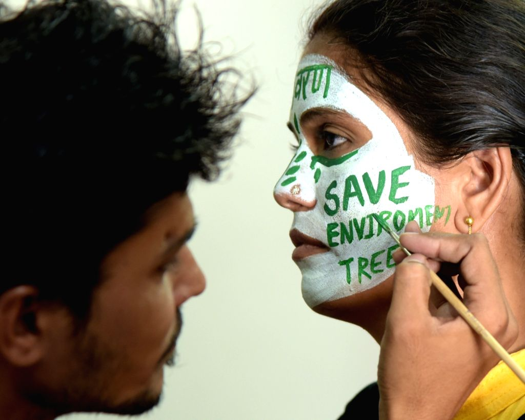 A girl gets her face painted to create awareness about environment ahead of the 'World Environment Day' in Bikaner on June 4, 2016.