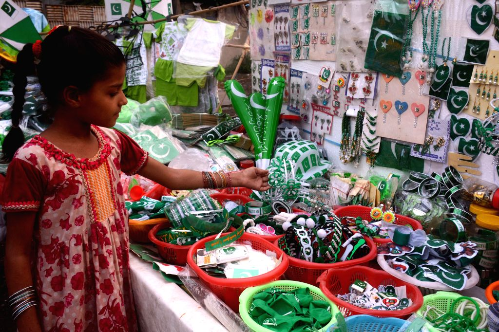 A girl looks at a badge at a market on the eve of the Independence Day in Lahore, Pakistan, on Aug. 13, 2020.