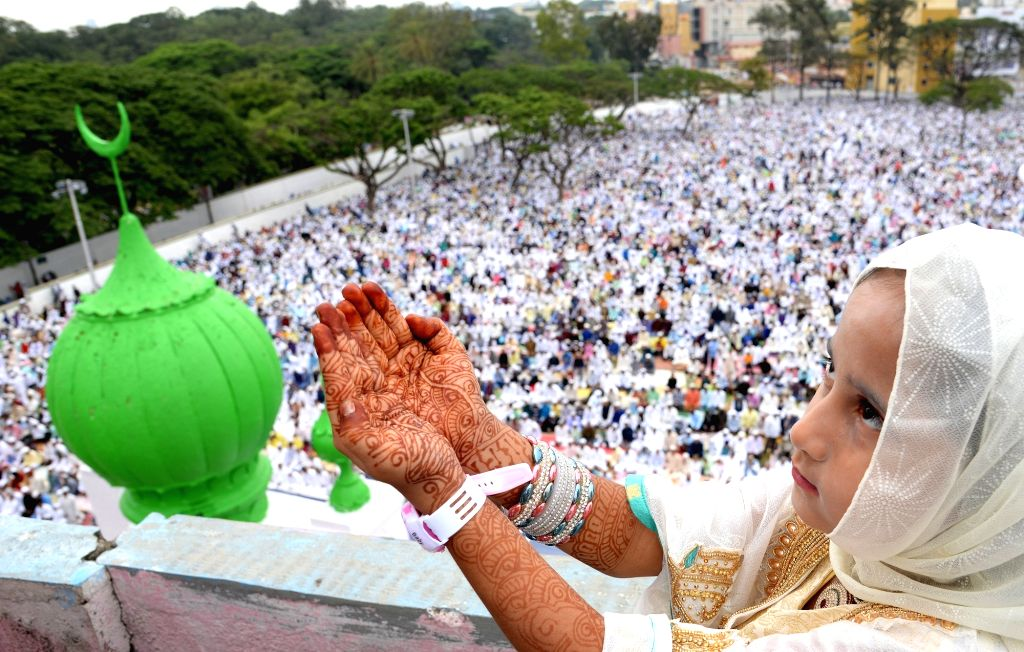 A girl offer prayers on the occasion of Eid-ul-Fitr at Idga Maidan in Bengaluru on June 26, 2017.