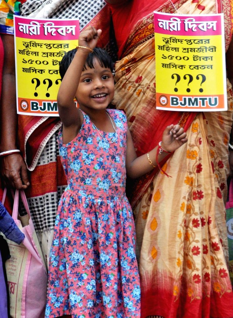 A girl participates in a demonstration staged by BJP workers, on International Women's Day 2019 in Kolkata, on March 8, 2019.