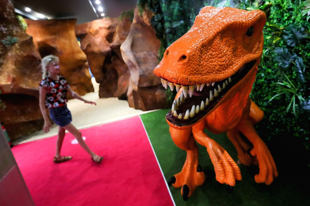 A girl visits the Smile Safari, an Instagram and TikTok museum, in Brussels, Belgium, August 7, 2020. After taking measures against the coronavirus, the Smile ...
