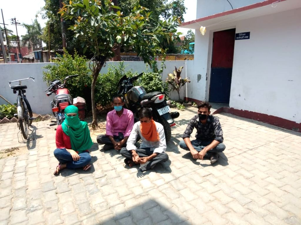 A girl who is a victim of molestation sit in demonstration over police inaction outside a police station in Shahjahanpur.
