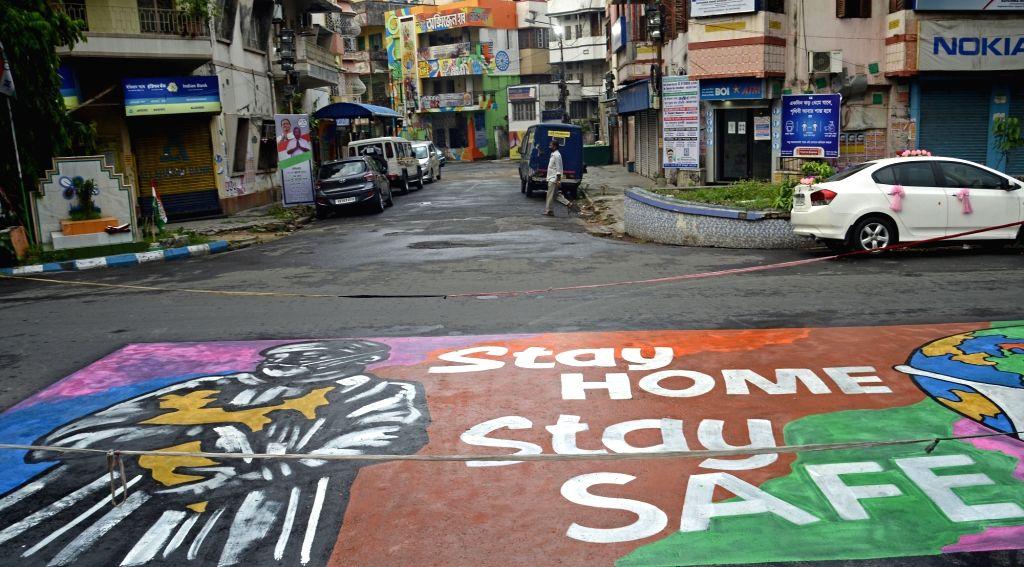 A graffiti at a deserted road for awareness campaign on Covid-19 during lockdown on Coronavirus pandemic in Kolkata on Saturday, may 22, 2021.