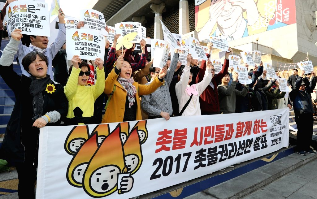 A group of anti-Park protestors shout during a rally in front of the Sejong Cultural Center in Seoul on March 11, 2017, a day after the Constitutional Court's removal of President Park ...