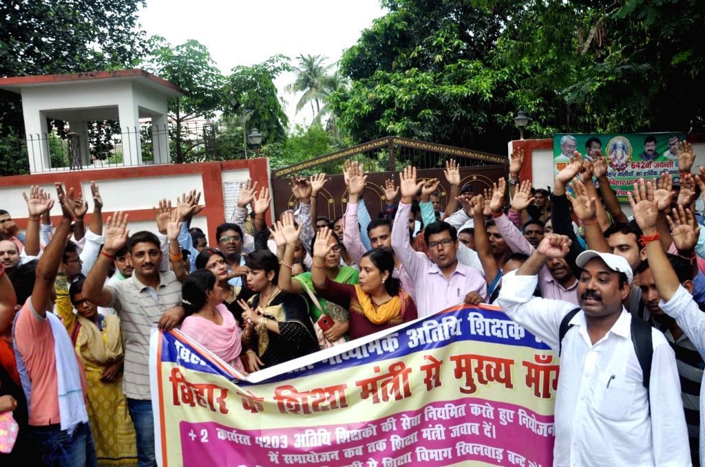 A group of contractual teachers 'gherao' Bihar Education Minister Krishna Nandan Prasad Verma's residence to press for their various demands, in Patna on July 17, 2019. - Krishna Nandan Prasad Verm and Nandan Prasad Verma