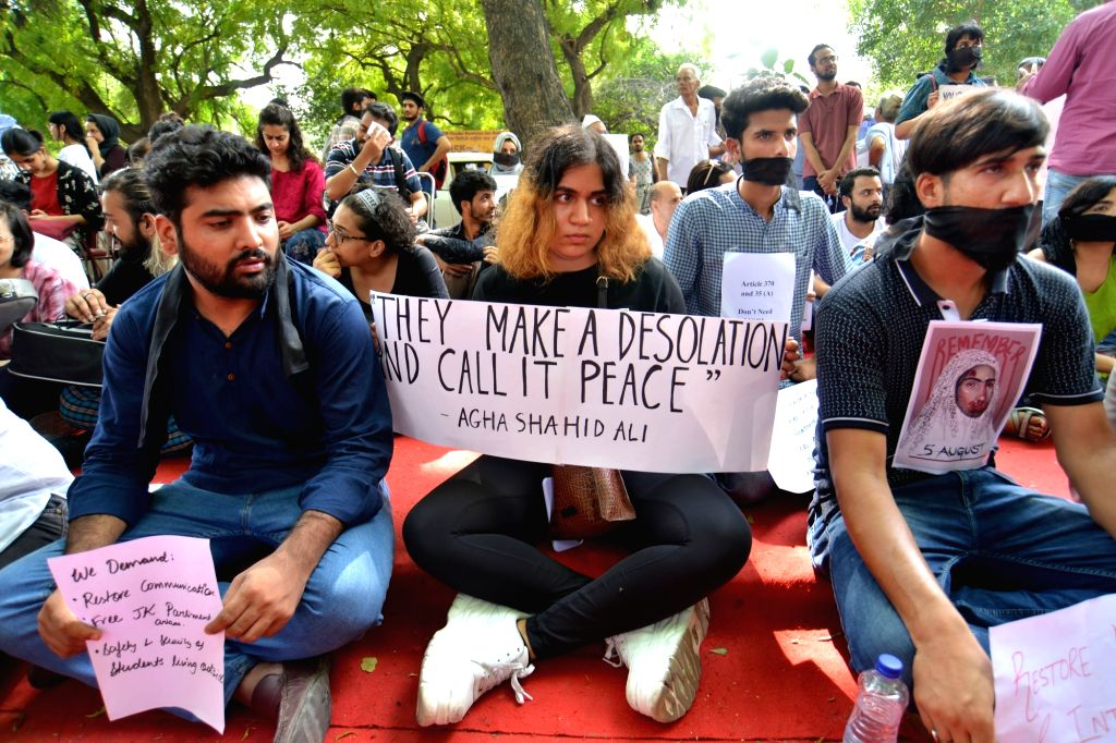 A group of Kashmiris residing in Delhi who are against the Union Government's decision to abrogate Article 370 of the Constitution that gave special status to Jammu and Kashmir; stage a ...
