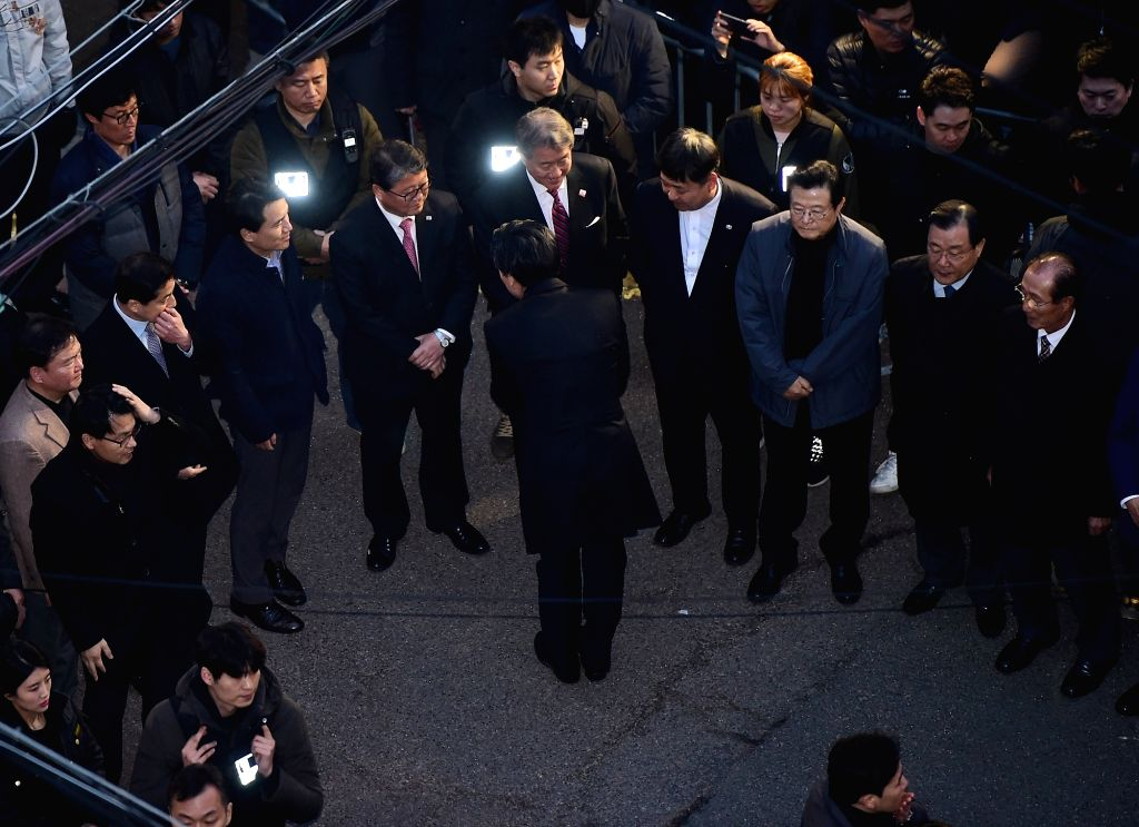 A group of lawmakers from the conservative Liberty Korea Party waits for the arrival of ousted President Park Geun-hye in front of her private residence in southern Seoul as she left the ...