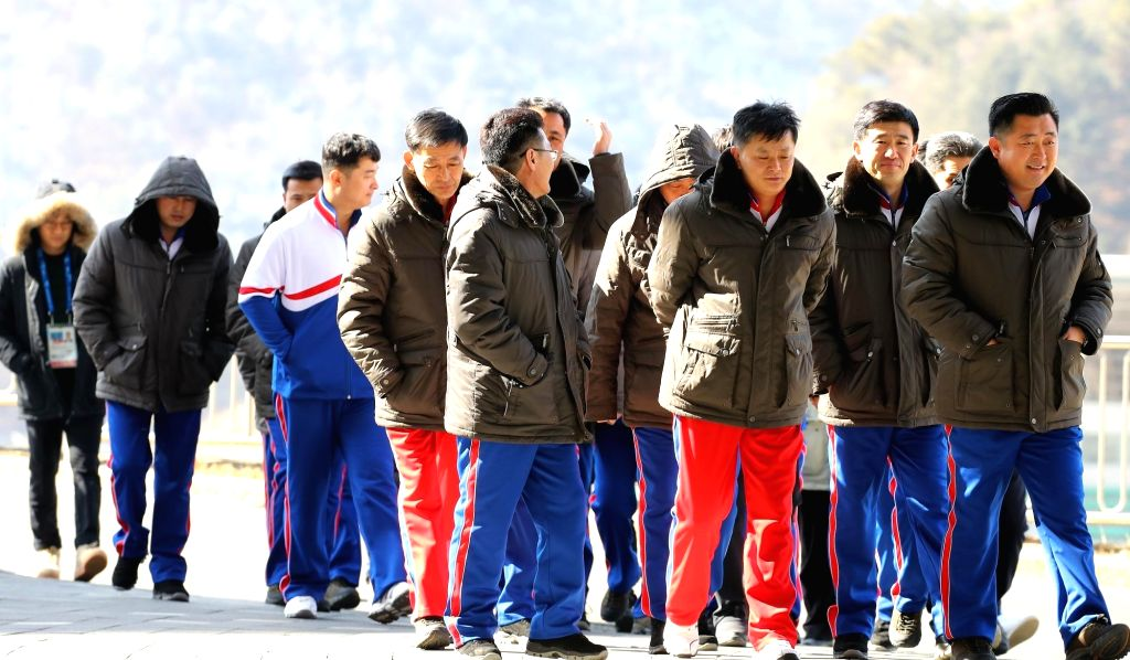 A group of North Korean reporters covering the PyeongChang Winter Olympics walks to lunch at Inje Speedium Hotel in Inje, 165 km northeast of Seoul, on Feb. 5, 2018. The hotel is the ...