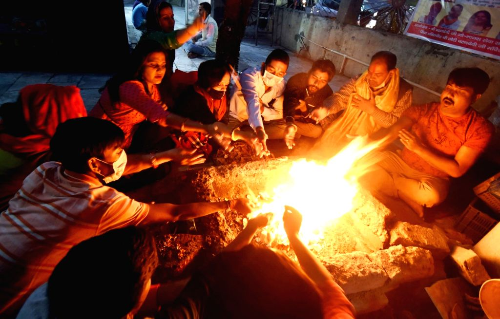A group of people perform 'havan' to pray for the elimination of COVID-19 and the speedy recovery of coronavirus victims, in Patna on March 21, 2020.