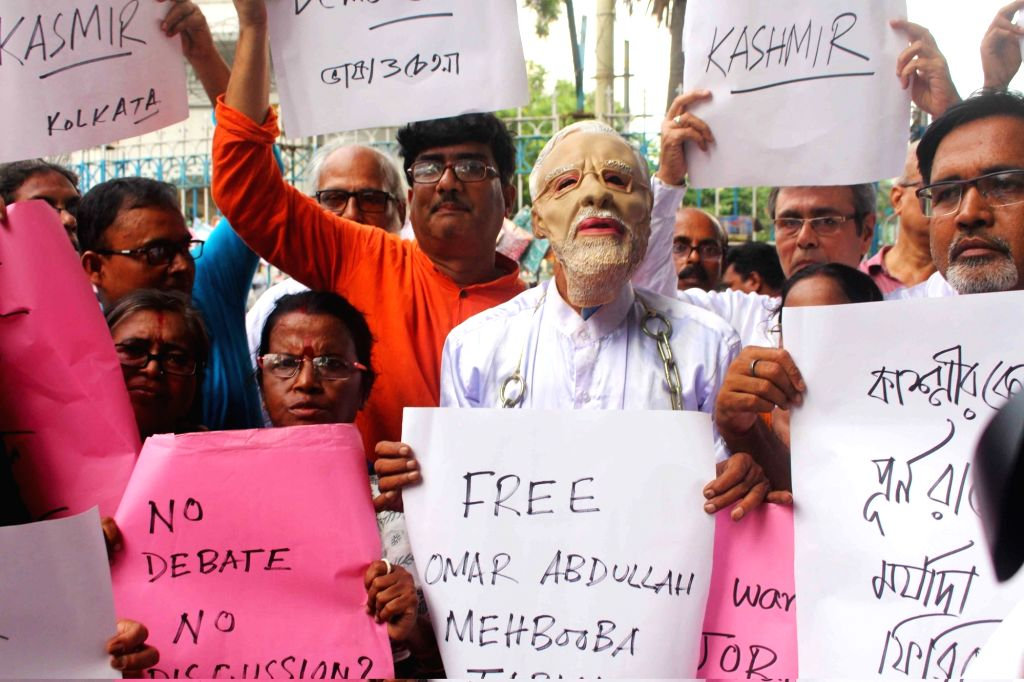 A group of people protest against the Centre's decision to scrap Article 370 of the Constitution that gives special powers to Jammu and Kashmir; in Kolkata on Aug 5, 2019.