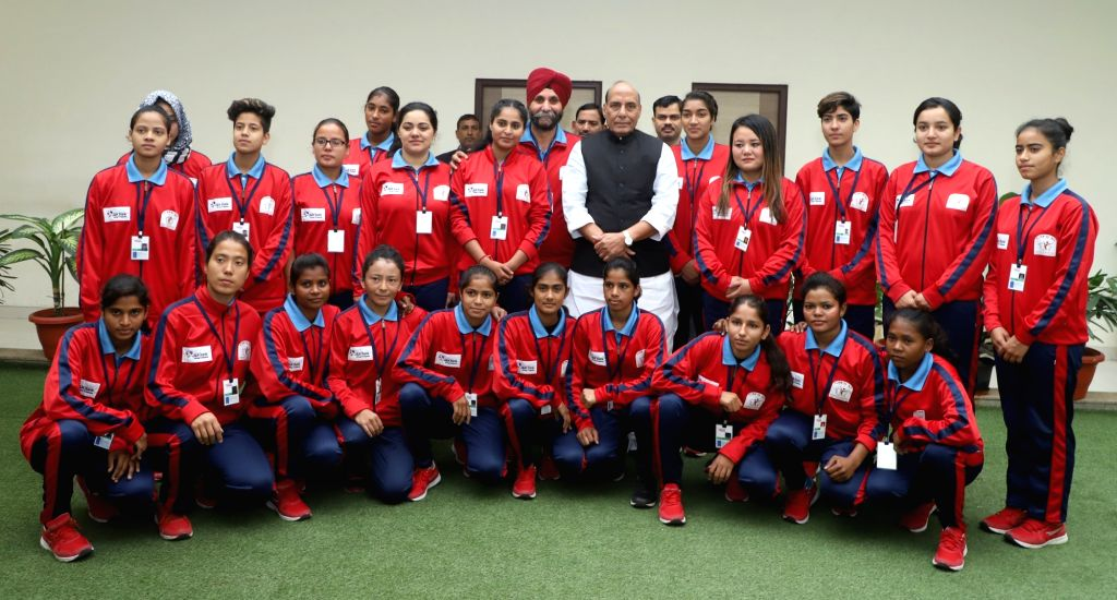 A group of women football players from Jammu and Kashmir calls on Union Home Minister Rajnath Singh in New Delhi on Dec 5, 2017. - Rajnath Singh