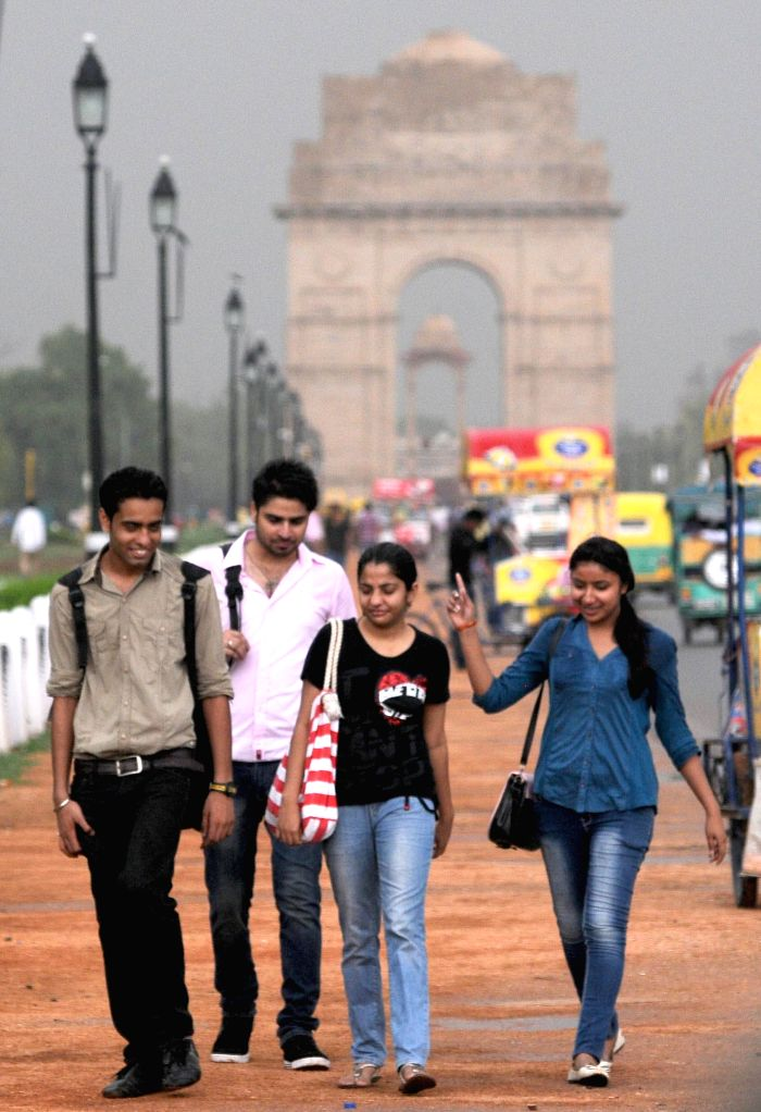 A group of youngster enjoys rains at India Gate in New Delhi on July 6, 2014.