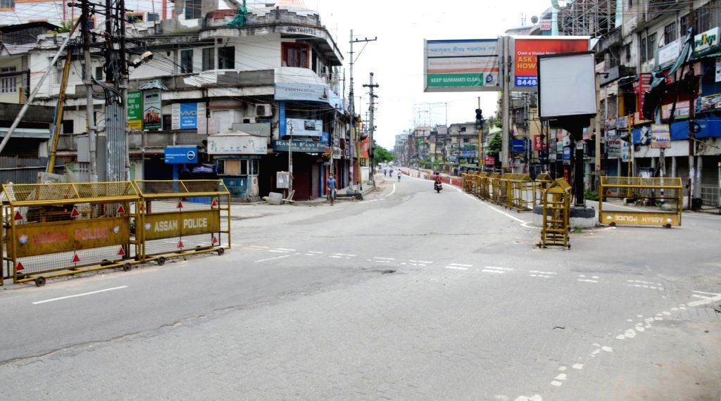 A Guwhatai road bears a deserted look after the district administration re-imposed lockdown for 14-days in 11 wards in Guwahati following a huge surge in the number of Covid-19 cases in ...