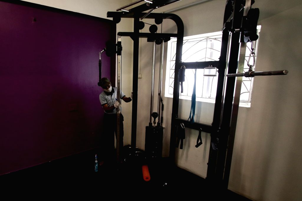 A gym being sanitised as it gears up to re-open amid COVID-19 pandemic in Chennai on Aug 6, 2020.