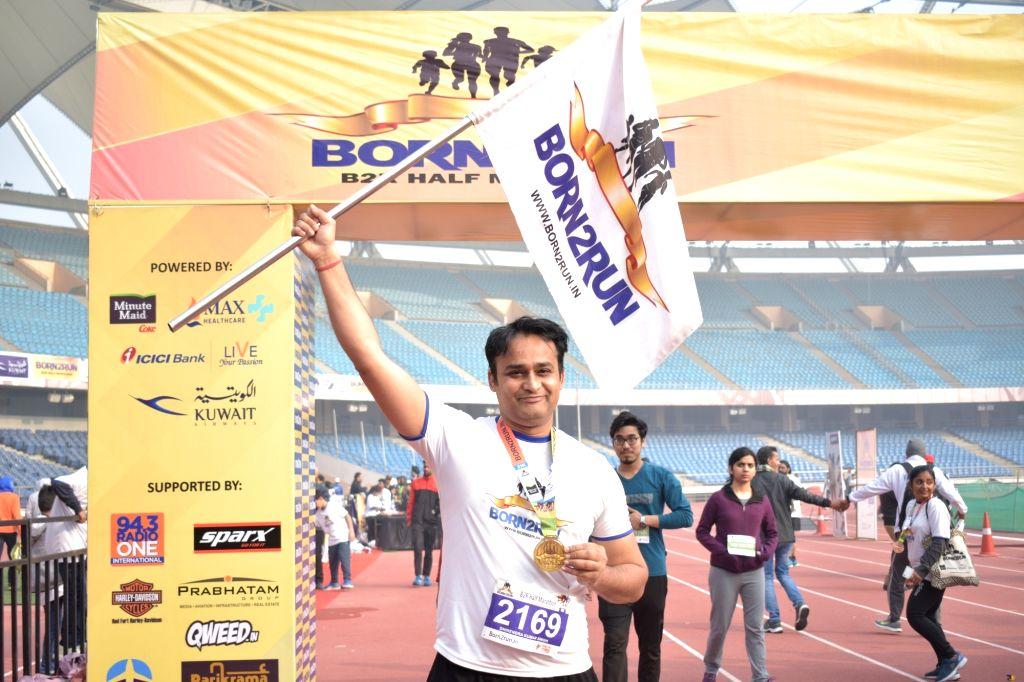 A happy marathoner ending the race.
