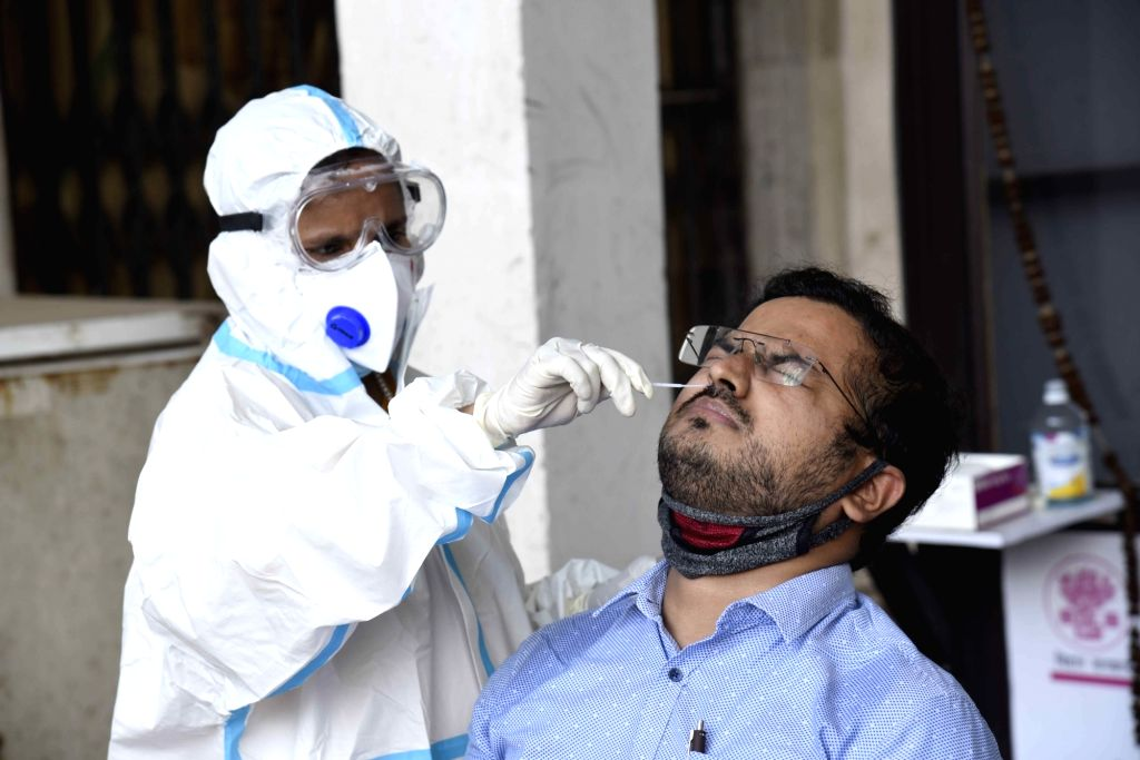 A health worker collects swab samples for COVID-19 testing, outside New Gardiner Road Hospital in Patna on Aug 31, 2020.