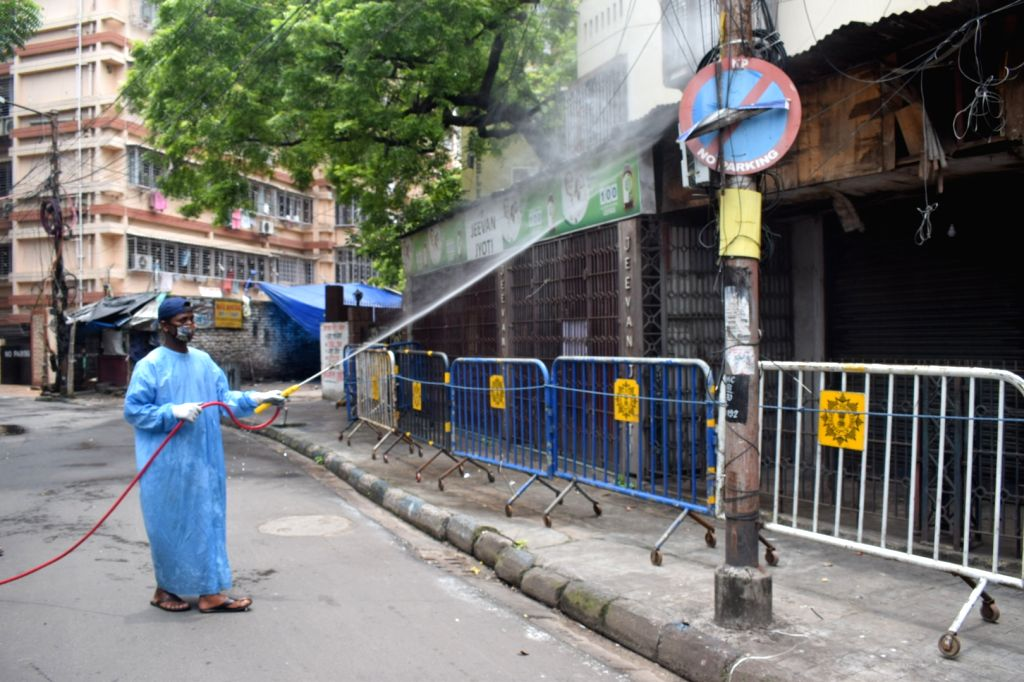 A health worker sanitises a COVID-19 containment zone in Kolkata during a complete lockdown imposed in all the designated containment zones across West Bengal, on July 11, 2020.
