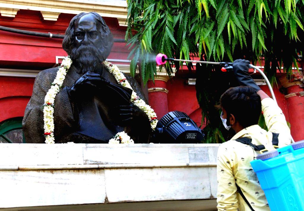 A health worker sanitized Rabindra Bharati and the statue of Rabindra Nath Thakur at Jorasanko Thakur Bari on the Birth anniversary of Rabindra Nath Thakur during the increasing numbers of ... - Rabindra Nath Thakur
