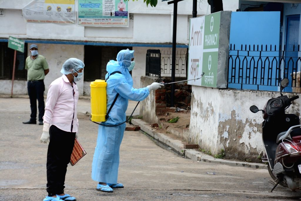 A health worker sprays dinsfectant at Nalanda Medical College and Hospital in Patna during the extended nationwide lockdown imposed to mitigate the spread of coronavirus; on Apr 26, 2020.