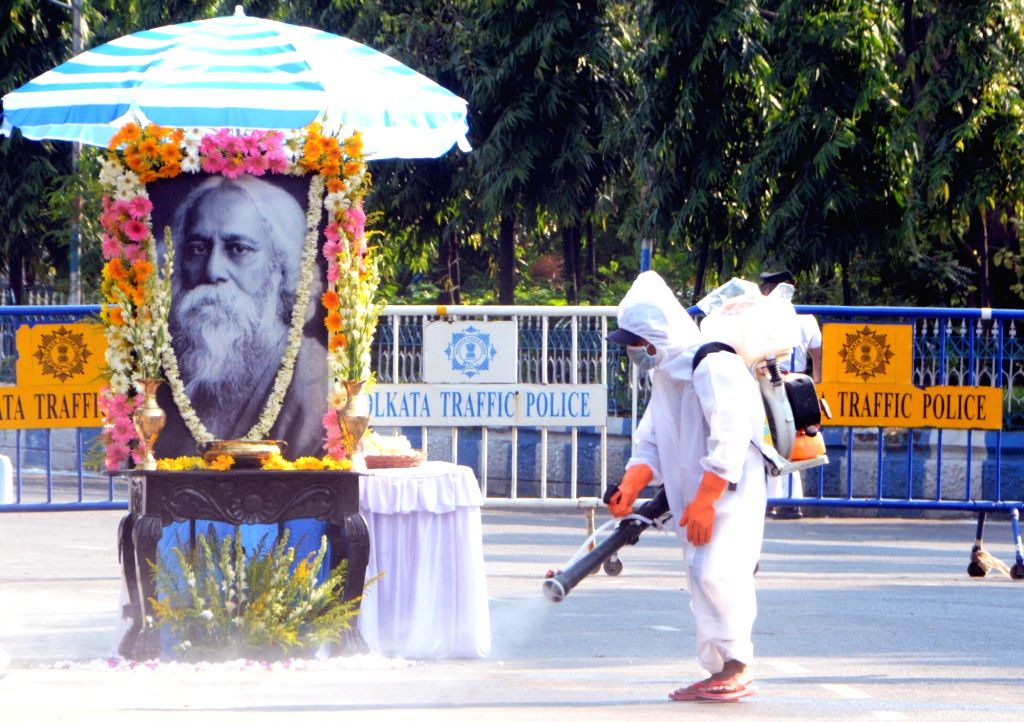 A health worker sprays disinfectants at the area where West Bengal Chief Minister Mamata Banerjee will pay tribute to Rabindranath Tagore on his birth anniversary during the extended ... - Mamata Banerjee