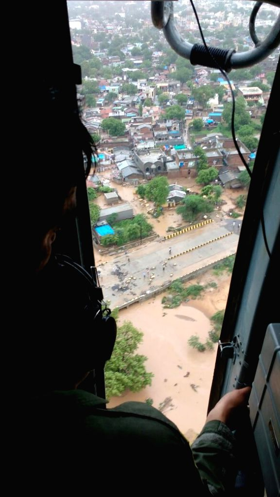 A helicopter carry out rescue operations during floods in Gujarat on July 25, 2017.