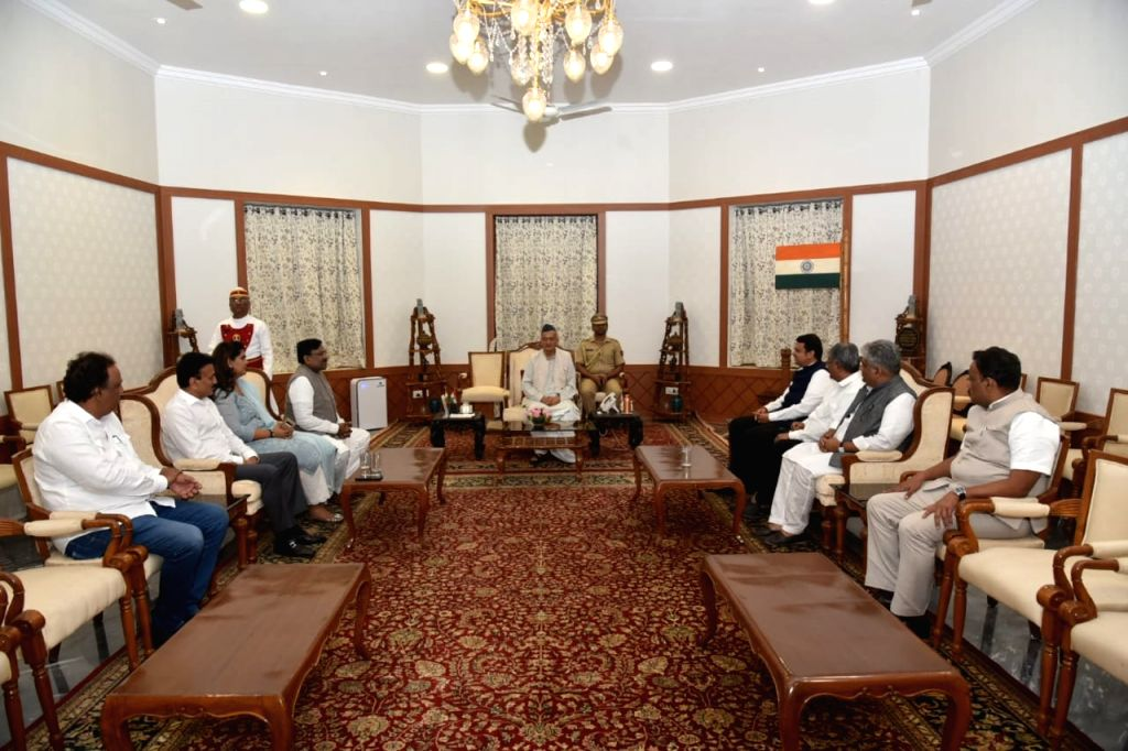 A high-level delegation led by Maharashtra BJP president Chandrakant Patil, outgoing Chief Minister Devendra Fadnavis and others meet Maharashtra Governor BS Koshyari in Mumbai on Nov 10, ... - Devendra Fadnavis and Chandrakant Patil