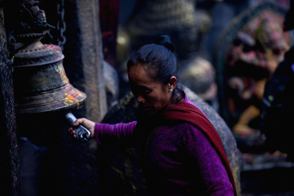 A Hindu devotee offers prayers during Bagh Bhairav festival at Bagh Bhairav temple in Kirtipur, Kathmandu, Nepal, Aug. 18, 2015. Devotees offer prayers and make ...
