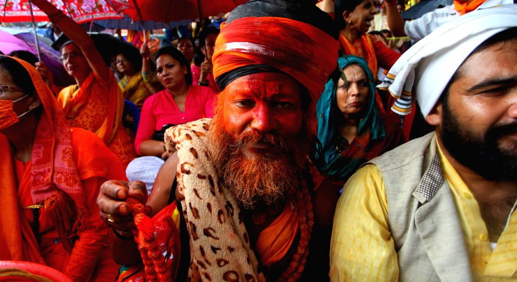 A Hindu priest participates in a protest demanding Nepal declared to be as a Hindu nation in new upcoming constitution in Kathmandu, Nepal, Aug. 7, 2015. Hindu ...