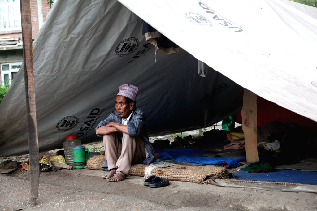 A homeless man rests at a temporary tent in Sankhu, on the outskirts of Kathmandu, Nepal, Aug. 15, 2015.