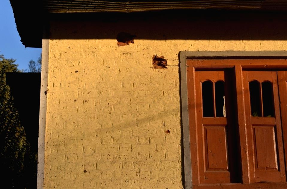 A house with marks of Pak artillery shell splinters in Riddi village.