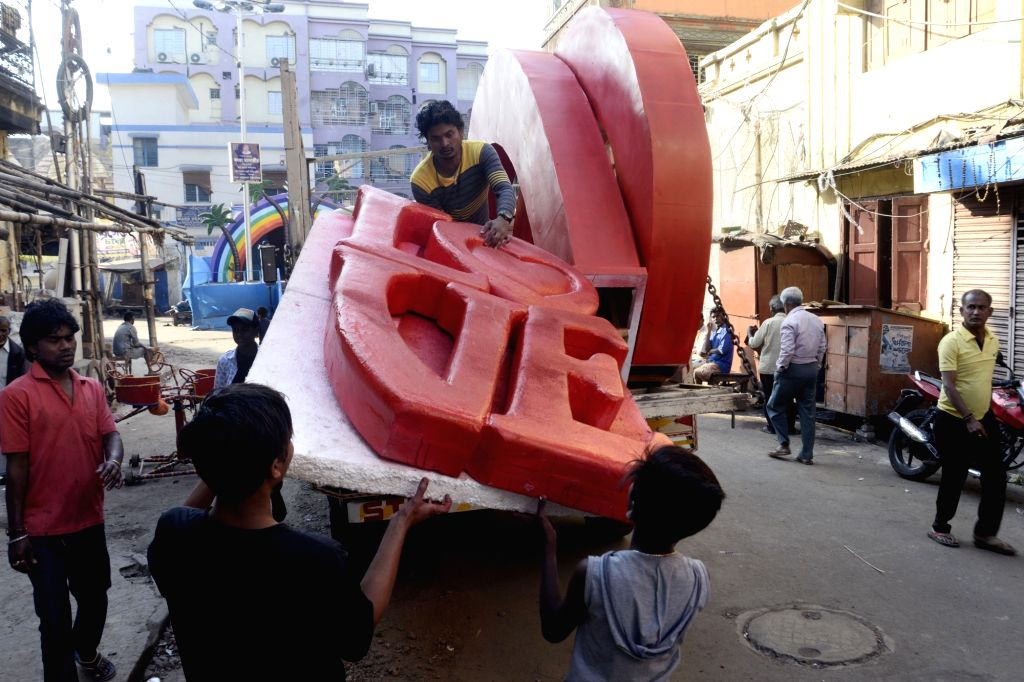 """A huge board reading """"Love"""" being transported ahead ahead of Valentine's Day in Kolkata on Feb 11, 2019."""