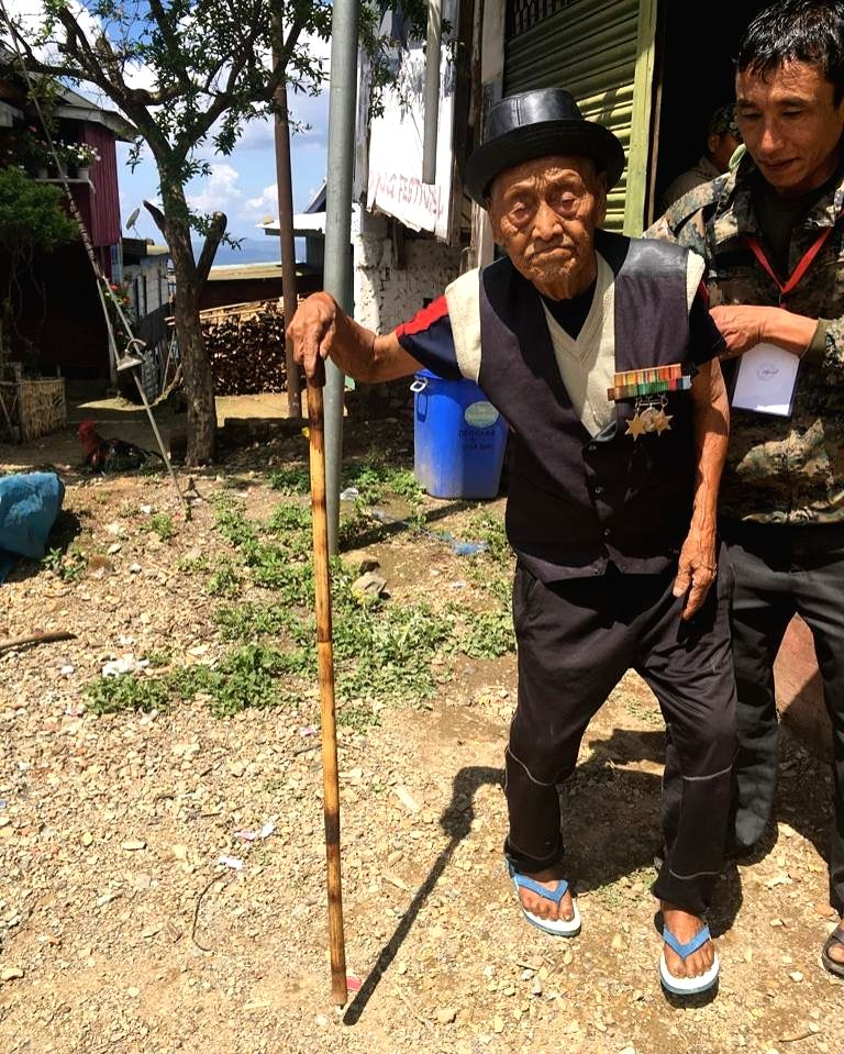 A hundred years plus voter being assisted to a polling booth for casting his vote for the first phase of 2019 Lok Sabha elections, in Nagaland's Mokokchung district, on April 11, 2019.