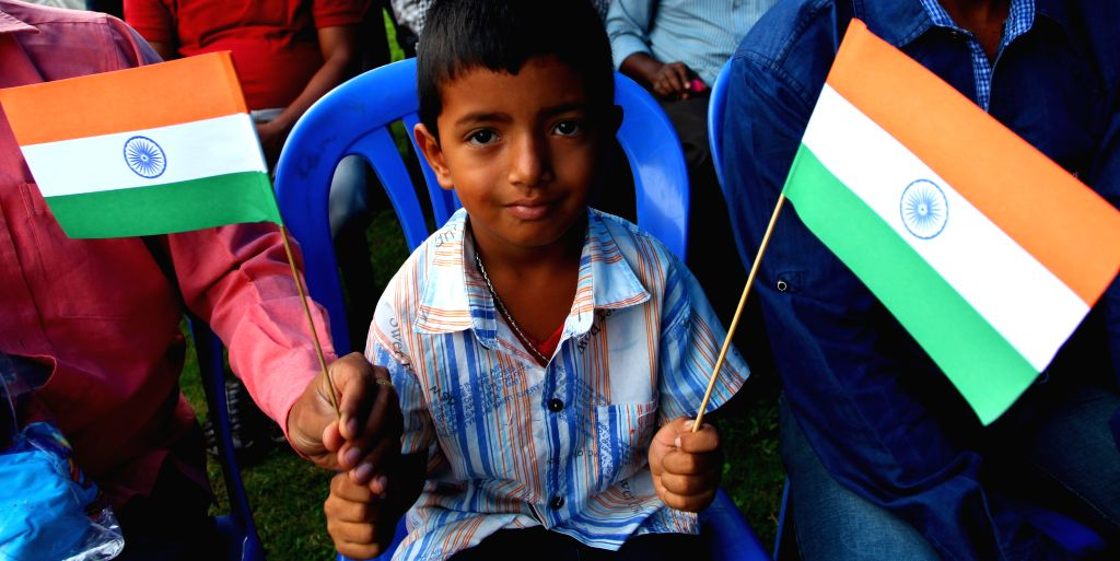 A Indian child holds India's national flag to mark the 69th Independence day of India at the Embassy of India in Lainchaur of Kathmandu, Nepal, Aug. 15, 2015. ...