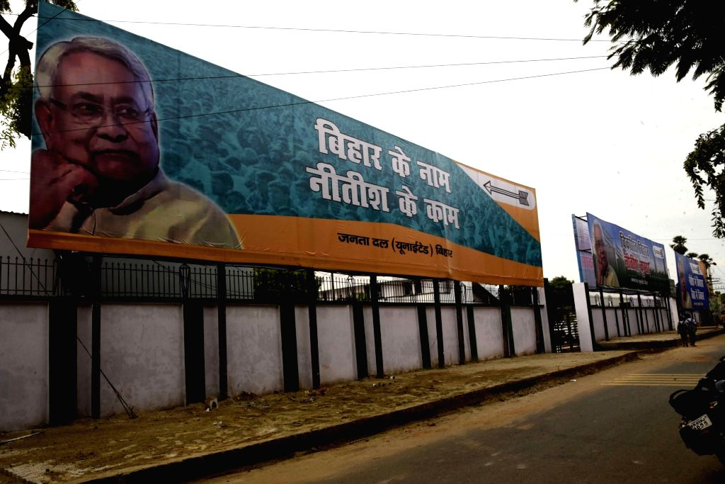 "A JD-U poster that reads ""Bihar Ke Naam, Nitish Ke Kaam"" praising Bihar Chief Minister Nitish Kumar's work in the state comes up at a Patna road ahead of the state assembly ... - Nitish Kumar"
