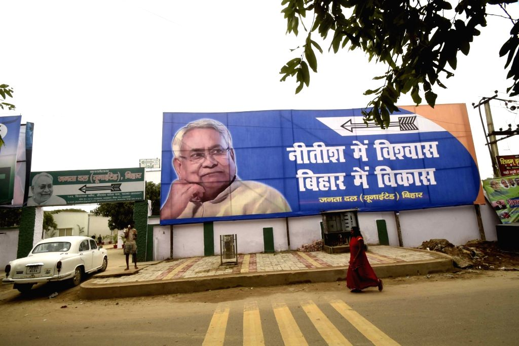 "A JD-U poster that reads ""Nitish Main Vishwas, Bihar Main Vikas"" praising Bihar Chief Minister Nitish Kumar's debelopment work in the state comes up at a Patna road ahead of the ... - Nitish Kumar"