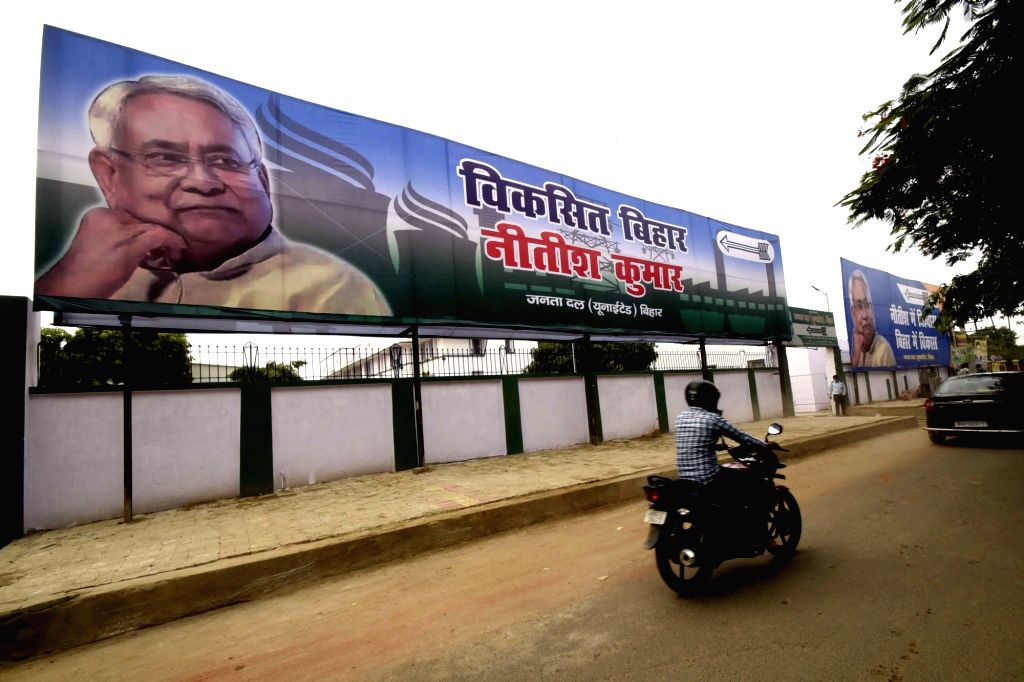 "A JD-U poster that reads ""Viksit Bihar, Nitish Kumar"" praising Bihar Chief Minister Nitish Kumar's development work in the state comes up at a Patna road ahead of the state assembly ... - Nitish Kumar"