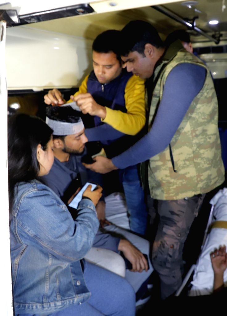 A JNU student receives first aid after he sustained injuries as the police allegedly baton-charged students while they tried to march towards the Rashtrapati Bhavan, during their protest ...