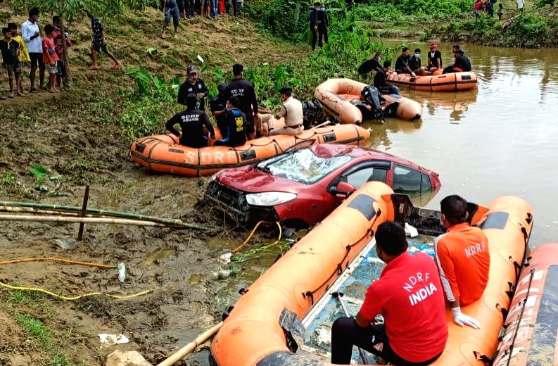 A joint team of National Disaster Response Force (NDRF) and State Disaster Response Force (SDRF) personnel recovered two dead bodies from a Hyundai i-10 car that had fallen into a river at ...