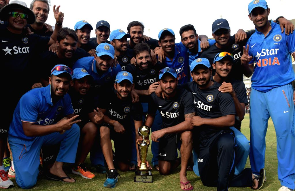 A jubilant India `A` team with the trophy during `India A Team Triangular Series` final match between India `A` and Australia `A` at MAC Stadium in Chennai, on Aug 14, 2015.