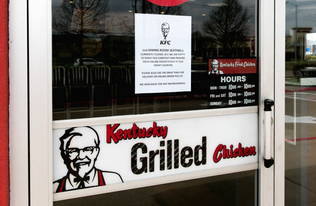 A Kentucky Fried Chicken fast food restaurant closes its dine-in room due to the spread of COVID-19 in Plano, Texas, the United States on March 19, 2020. U.S. ...