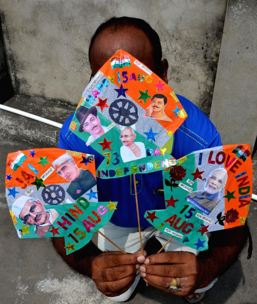 A kite-maker shows specially designed Independence Day-themed kites with the pictures of freedom fighters, Former Indian Prime Ministers and Prime Minister Narendra Modi on them, in ... - Narendra Modi