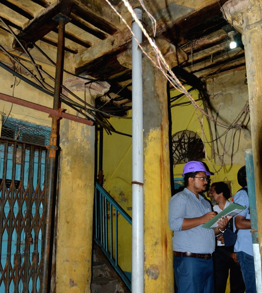 A Kolkata Metro Railway officer inspects a house damaged in the underground tunnelling work for the East-West Metro Project at Bowbazar area in Kolkata, on Sep 13, 2019.
