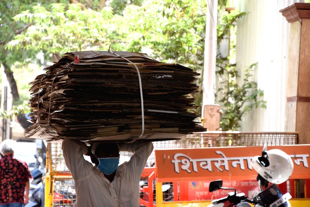 A laborer wears a mask while at work as a precautionary measure against COVID-19 (coronavirus), in Mumbai on March 20, 2020.