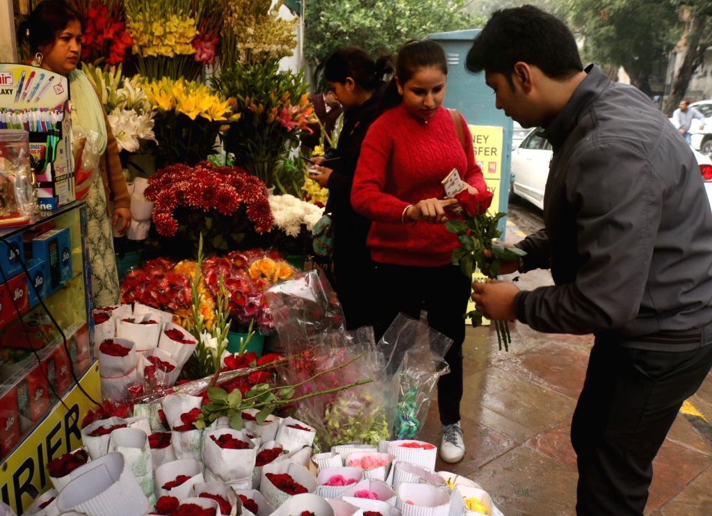 A lady busy selecting roses on Valentine's Day in New Delhi, on Feb 14, 2019.