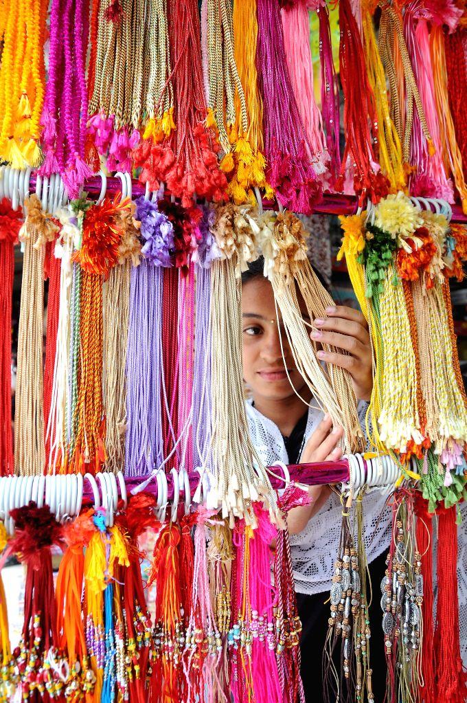 A lady busy shopping ahead of `Raksha Bandhan`in Bangalore on Aug 6, 2014.