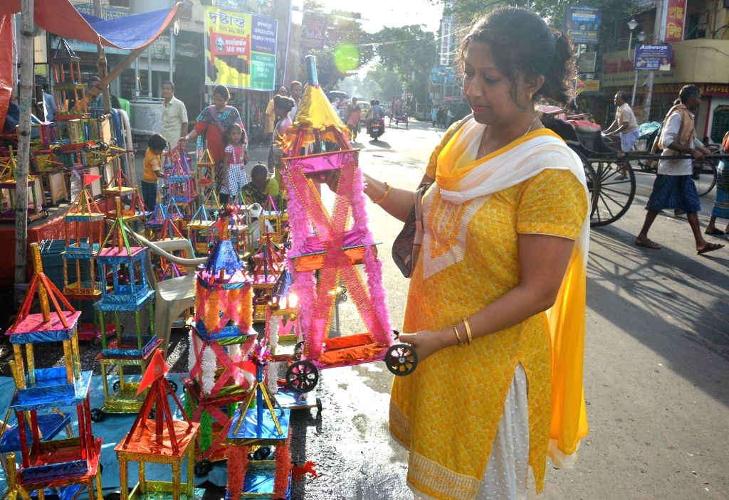 A lady buys a rath -chariot- on the eve of Jagannath Rath Yatra in Kolkata, on July 13, 2018.