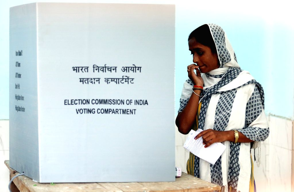 A lady casts her vote during the fourth phase of 2019 Lok Sabha elections, in Unnao, Uttar Pradesh on April 29, 2019.