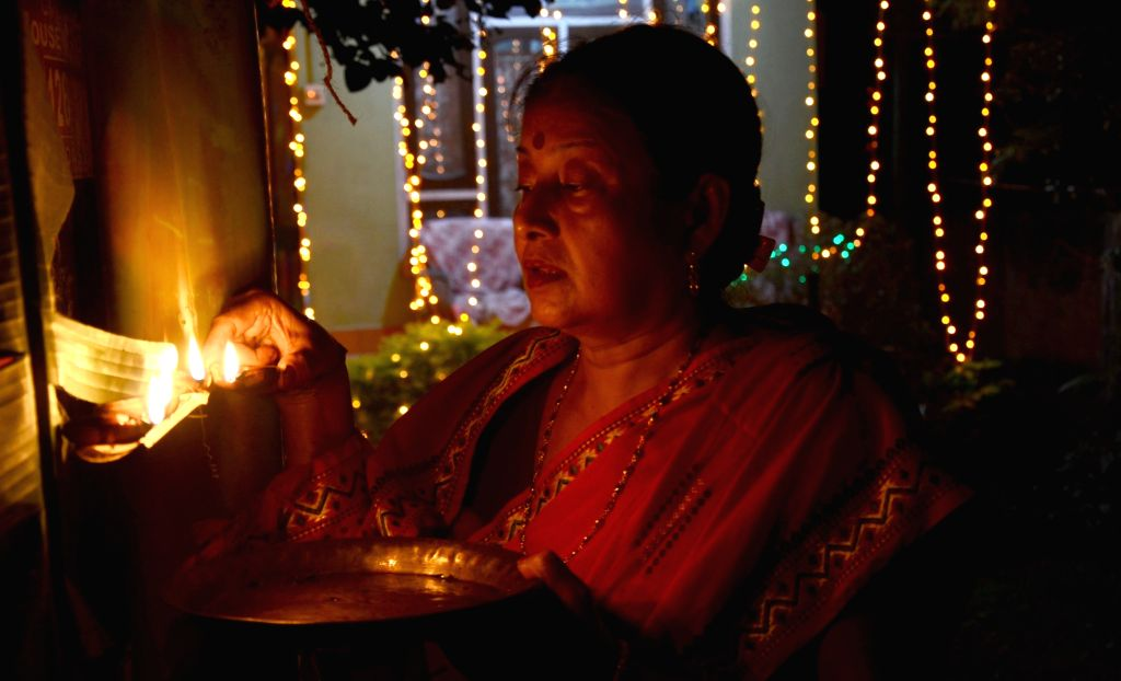 A lady celebrates Diwali in Guwahati, on Oct 30, 2016.