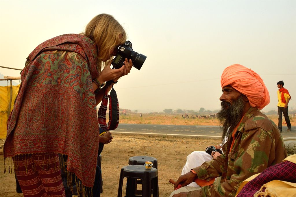 A lady clicks pictures of a man during Pushkar Fair in Rajasthan on Nov 16, 2015.