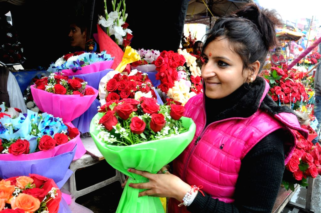 A lady holding a bouquet on Valentine's Day in Amritsar, on Feb 14, 2019.